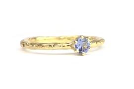 Verlovingsring met lichtblauwe spinel