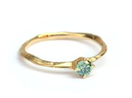 Verlovingsring met mintgroene diamant
