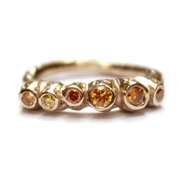 Coral ring with cognac diamonds