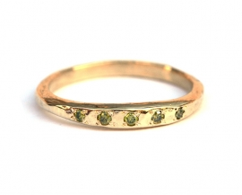 Ring with little apple green diamonds