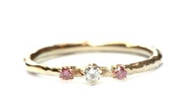 Snoepjesring met roze en witte diamant