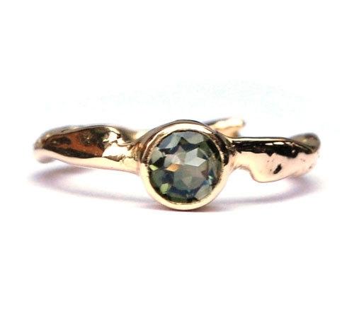 Ring 18krt goud met groene tourmalijn