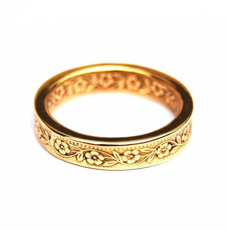 Fairtrade gold ring with double flower motif