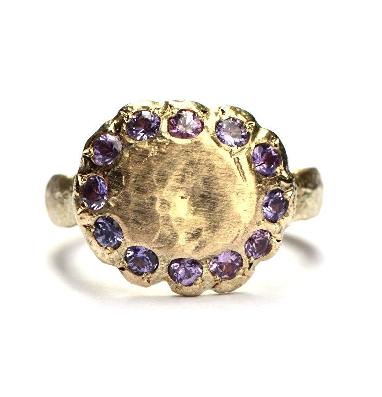 Flower ring with purple sapphires
