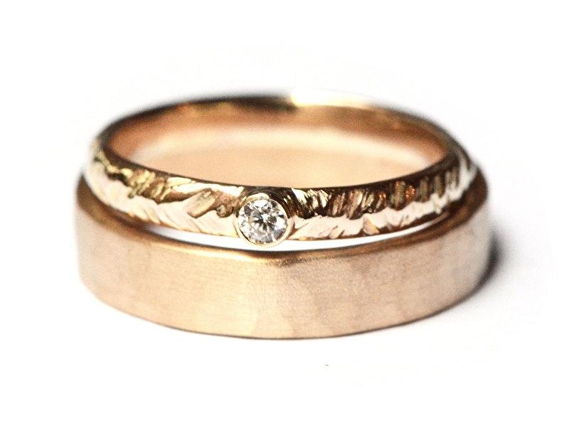 Trouwringenset met veermotief en diamant