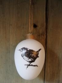 Kerstbal van glas met vogel