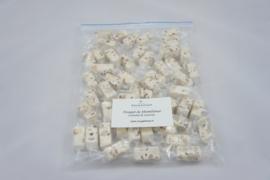zak met 500 gram ind. verpakte nougatblokjes  Caramel & Zeezout, geschikt voor brievenbuspost !