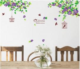 Muursticker takken met paarse bloemen en vogelkooi