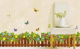 Muursticker hek met blaadjes, bloemen en vlinders strook