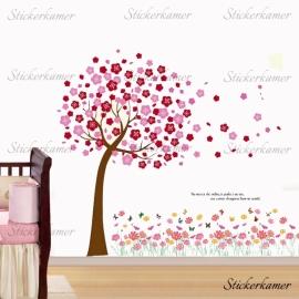 Boom met roze en rode bloesem bladeren en roze bloemen