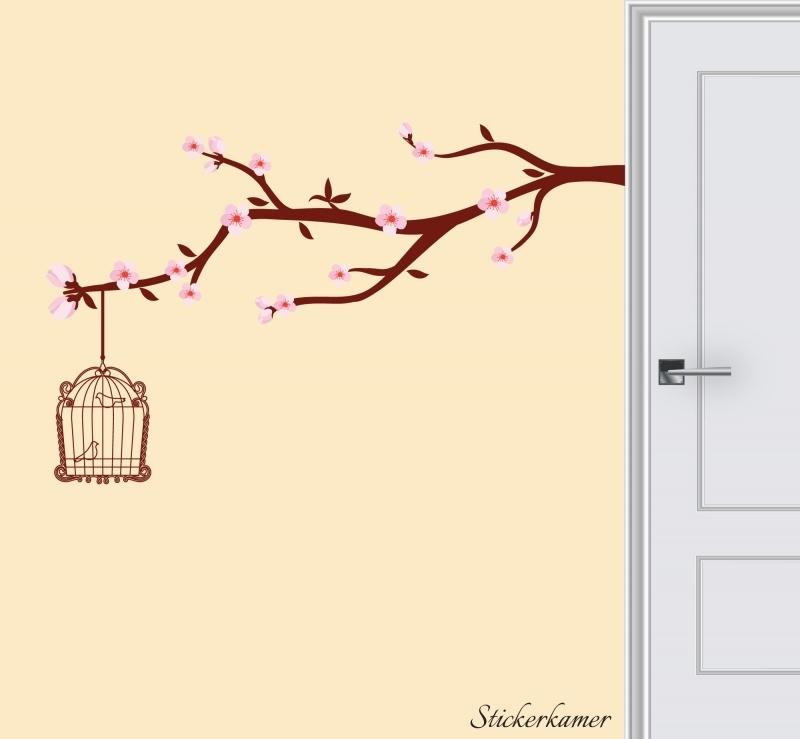 Roze bloesem tak met vogelkooi