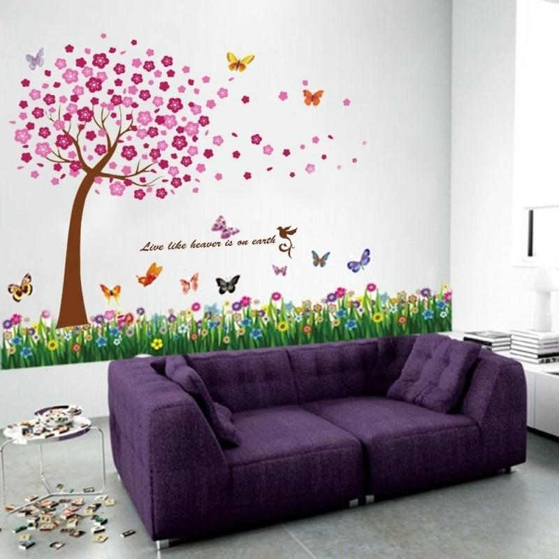 Muursticker roze bloesem boom met gras, bloemen en vlinders