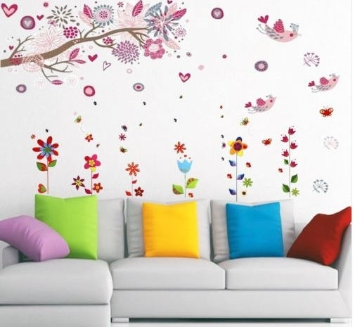 Muursticker tak met roze bloesem, vogels en bloemen