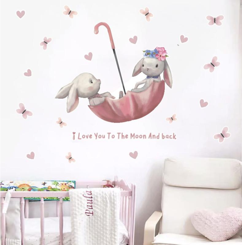 Muursticker konijn paraplu en vlinders roze kinderkamer