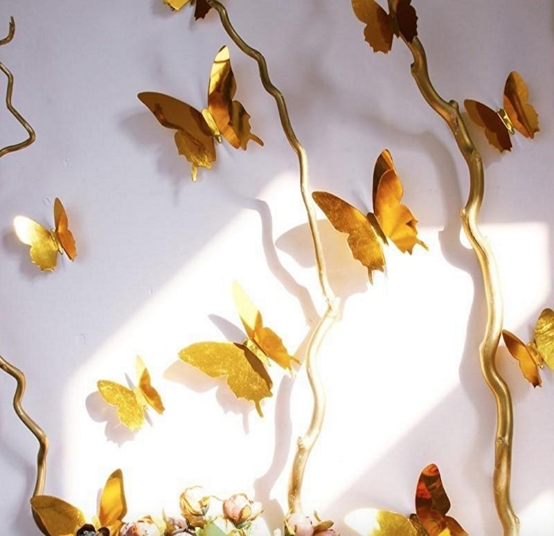 Muursticker losse 3d vlinders (goud)