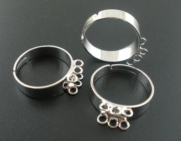 Ring verstelbaar met 6 oogjes zilver