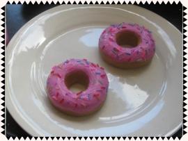 Donuts met roze glazuur en spikkels