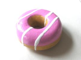 Donuts met roze glazuur en swirl wit