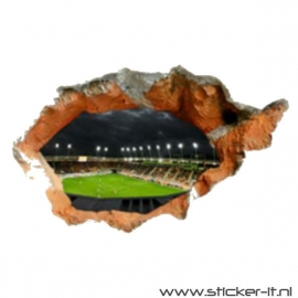 Uitgebroken muur voetbalveld