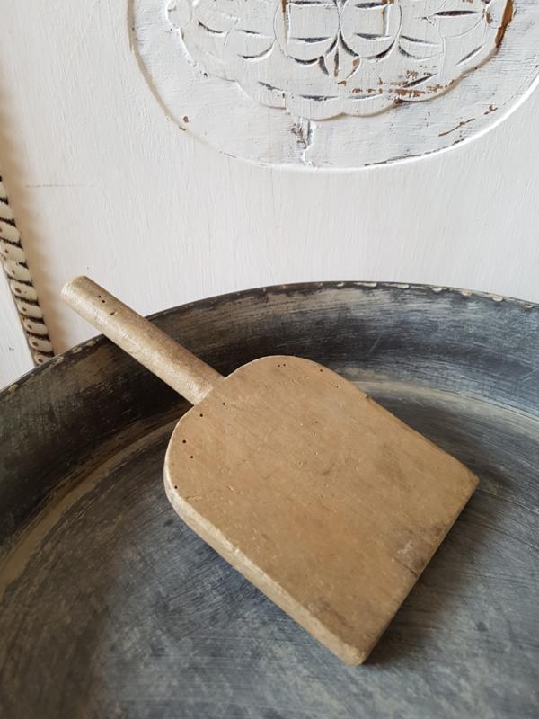 Oude houten spatel