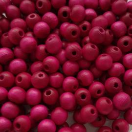 Houten kraaltje fuchsia roze - ca. 6mm