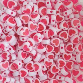 Acryl kraal hartvorm roze