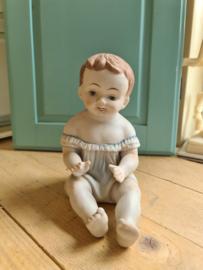 Oude porseleinen piano baby nr3