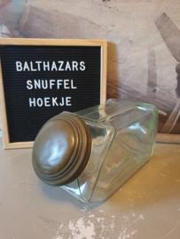 Oude liggende glazen snoeppot