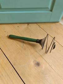 Oud keukengerei klutser groen