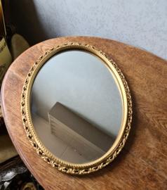 Oude houten goudkleurige ovale spiegel