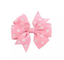 Haarspeldjes: roze strik met stipjes