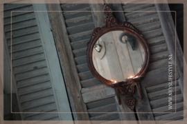 Spiegel met kaarsenhouders