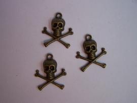 Schedel met gekruiste botten brons