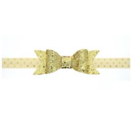 Haarband met grote goudkleurige glitterstrik