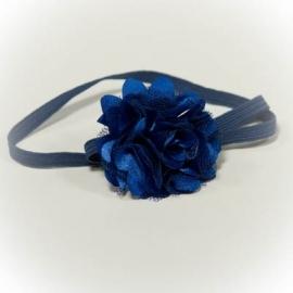 Haarbandje met donkerblauwe bloem