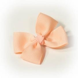 Peach kleurige strik