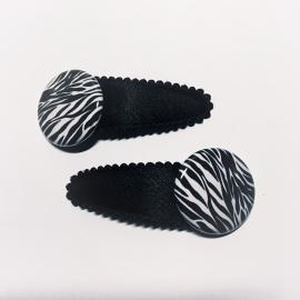 Zwarte clip met zebra print prijs per stuk