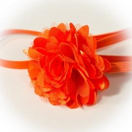 Haarband met oranje roeseltje
