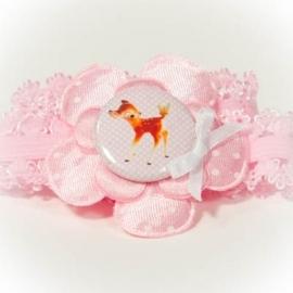 Lichtroze hertje button met fuchsia roze bloem