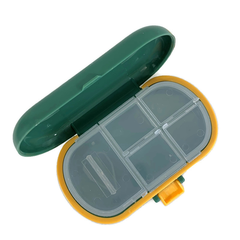 2 in 1 Pillensnijder en Pillendoosje STORAGE groen
