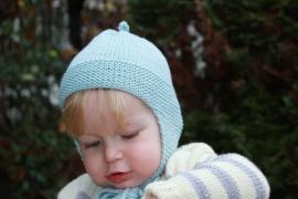 Handgebreide merino babymuts in lichtaqua