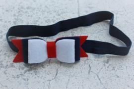 Handgemaakte haarband met dubbele vilten strik in donkerblauw, rood en wit
