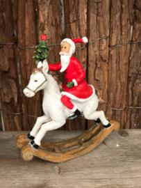 Polyester kerstman op hobbelpaard
