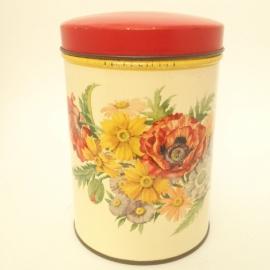 Vintage blik hoog met bloemen