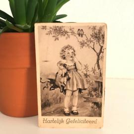 Ansichtkaart uit de jaren '60; Meisje met pop
