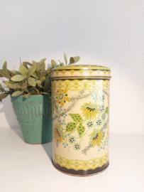 Vintage blik hoog zacht geel met groen bloem decor