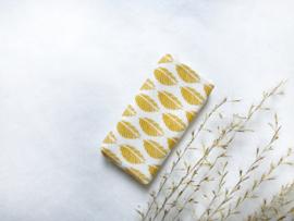 Textiel | beddengoed | ledikant matras | oker geel