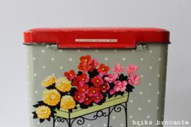 blik  grijs met bloemen