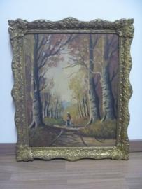 Schilderij 'vrouw in bos' in mooie, goudkleurige lijst