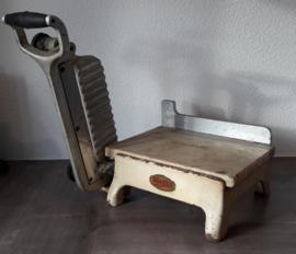Oude, vintage Unika kaassnijder